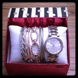 8 piece watch and bracelet set.